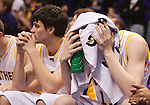 March 08 2009 Northern Iowa players were nervous on the bench in the waning minutes of regulation time as the Illinois State team wasn't ready to give up and sent the game into overtime.  The players, from left, are  Kerwin Dunham (22) and Johnny Moran (13, with towel over head).  The Panthers of the University of Northern Iowa defeated the Redbirds of Illinois State University 60-57 in overtime in the championship game of the Missouri Valley Conference Tournament on Sunday March 8, 2009 at the Scottrade Center in downtown St. Louis, Missouri.   ..         *******EDITORIAL USE ONLY*******