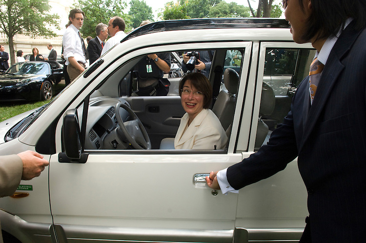 WASHINGTON, DC - June 12: At a news conference on oil dependence and global warming, Sen. Amy Klobuchar, D-Minn., checks out a Miles ZX405, an all-electric vehicle produced by Miles Electric Vehicles. The company was founded in 2004 by entrepreneur and philanthropist Miles Rubin. The ZX405 is capable of 25mph and has a range of 40-50 miles. Miles Electric Vehicles is owned by Miles Automotive Group, Ltd, and headquartered at the historic Santa Monica Airport in Santa Monica, CA. (photo by Scott J. Ferrell/Congressional Quarterly)