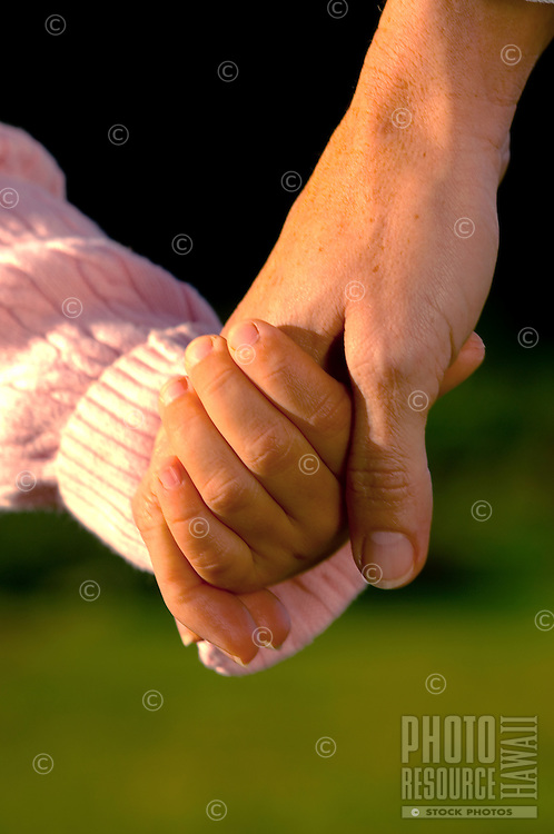 Mother & Daughter Holding Hands
