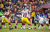 New York Giants quarterback Eli Manning (10) calls signals in the first quarter against the Washington Redskins at FedEx Field in Landover, Maryland on Thursday, November 23, 2017.  Pictured are: Washington Redskins inside linebacker Zach Brown (53); New York Giants center Brett Jones (69); Washington Redskins defensive tackle Matthew Ioannidis (98); New York Giants offensive guard John Jerry (77); and, in the backfield, New York Giants tight end Shane Smith (43).<br /> Credit: Ron Sachs / CNP<br /> (RESTRICTION: NO New York or New Jersey Newspapers or newspapers within a 75 mile radius of New York City)