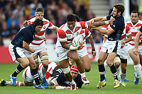 Amanaki Mafi of Japan fends Greig Laidlaw of Scotland. Rugby World Cup Pool B match between Scotland and Japan on September 23, 2015 at Kingsholm Stadium in Gloucester, England. Photo by: Patrick Khachfe / Stewart Communications