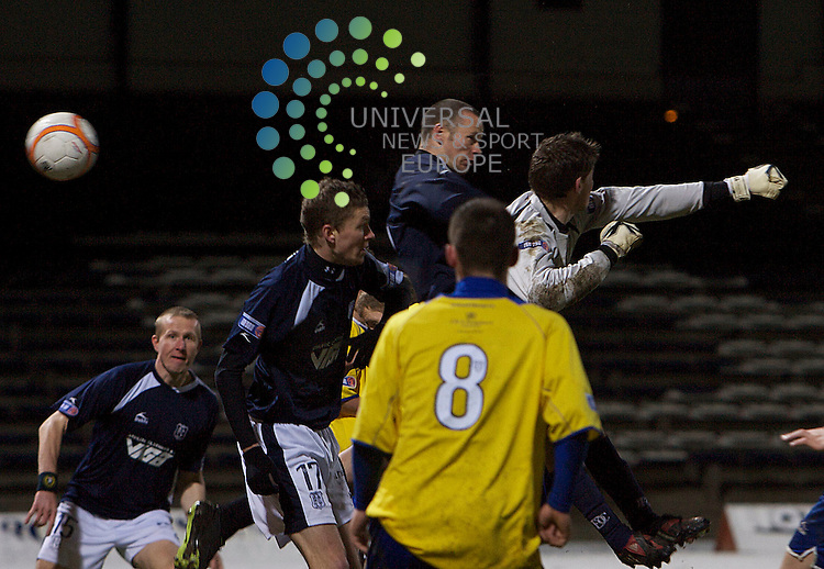 Scottish Irn-Bru First Division Championship Season 2009/10.Dundee Football Club  v  Greenock Morton  Football Club... Eddie Malone of Dundee scores the 3rd     , during today's thrilling encounter between League Leaders Dundee and Greenock Morton at Dundee's Dens Park...Picture, Mark Davison/Universal News and Sport.