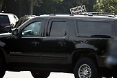 United States President Donald J. Trump's limo passes by a protestor outside Trump National Golf Club in Sterling, Virginia on Saturday, June 8, 2019.<br /> Credit: Yuri Gripas / Pool via CNP