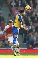 Charlie Austin of Southampton and Lucas Torreira of Arsenal during Arsenal vs Southampton, Premier League Football at the Emirates Stadium on 24th February 2019
