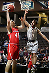 SIOUX FALLS, SD - MARCH 12:  Ben Carlson #42 from Indiana Wesleyan lays the ball up past Bishop Smith #10 from IU East during their semifinal game at the 2018 NAIA DII Men's Basketball Championship at the Sanford Pentagon in Sioux Falls. (Photo by Dave Eggen/Inertia)