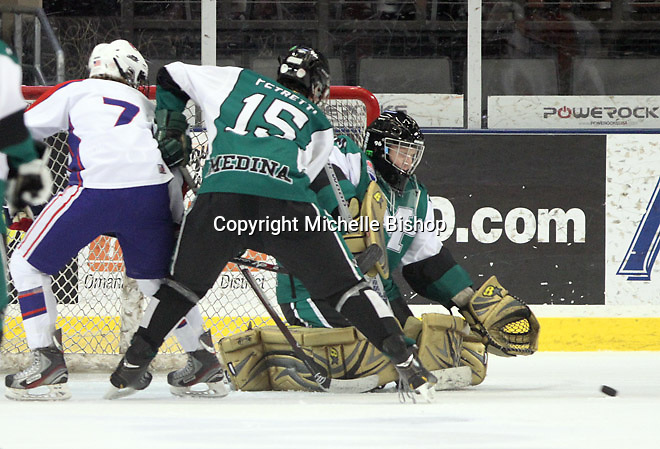 Medina's Tony Petretti (15) and goalie Matt Hatcher (40). Cherry Creek (Colorado) beat Medina (Ohio) 5-1 on the third day of pool play during the 2014 High School Hockey National Championship in Omaha on March 28. (Photo by Michelle Bishop)