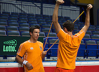 29-01-2014,Czech Republic, Ostrava,  Cez Arena, Davis-cup Czech Republic vs Netherlands, practice, Igor Sijsling (NED) assists Robin Haase (NRD) in doing his warming up<br /> Photo: Henk Koster