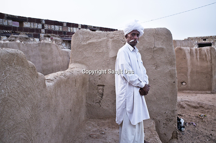 66-year-old Manganiyar artist, Lakha Khan poses for a portrait outside his house in Raneri village of Jodhpur district in Rajasthan, India. Photo: Sanjit Das/Panos