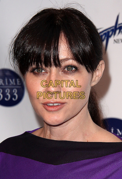SHANNEN DOHERTY.Sapphire Gentlemen's Club and Prime 333 Grand Opening Celebration held at Bar Artisanal, New York, NY, USA..April 27th, 2009.headshot portrait black purple fringe bangs .CAP/ADM/PZ.©Paul Zimmerman/AdMedia/Capital Pictures.