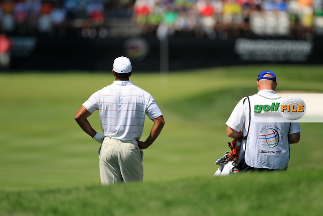 Tiger Woods (USA) and caddy Joe Lacava wait to play his 2nd shot on the 9th hole during Thursday's Round 1 of the 2012 World Golf Championship Bridgestone Invitational at The Firestone Country Club, Akron, Ohio, USA 2nd August 2012 (Photo Eoin Clarke/www.golffile.ie)