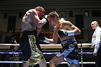 DP Carr (black/white shorts) defeats Paul Holt during a Boxing Show at York Hall on 2nd March 2018