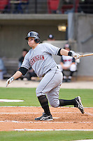 C.J. Retherford #10 of the Birmingham Barons follows through on his swing versus the Carolina Mudcats at Five County Stadium August 16, 2009 in Zebulon, North Carolina. (Photo by Brian Westerholt / Four Seam Images)