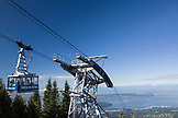 CANADA, Vancouver, British Columbia, View of the Skyride Gondola at Grouse Mountain wtih the city of Vancouver in the distance
