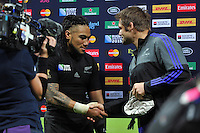 Ma'a Nonu of New Zealand shakes hands with All Blacks skipper Richie McCaw on the occasion of his 100th cap. Rugby World Cup Pool C match between New Zealand and Tonga on October 9, 2015 at St James' Park in Newcastle, England. Photo by: Patrick Khachfe / Onside Images