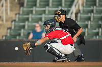 Kannapolis Intimidators catcher Daniel Gonzalez (30) reaches for a pitch as home plate umpire Jude Koury looks on during the game against the West Virginia Power at Kannapolis Intimidators Stadium on July 19, 2017 in Kannapolis, North Carolina.  The Power defeated the Intimidators 7-4 in 11 innings.  (Brian Westerholt/Four Seam Images)