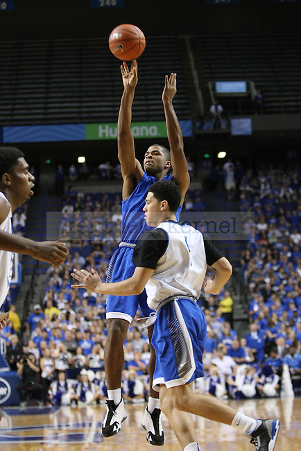 Aaron Harrison shoots a 3-point shot during the Blue and White Scrimmage in Rupp Arena in Lexington, Ky., on Monday, October 27,  2014. Photo by Emily Wuetcher | Staff