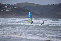 200531-Kite and Wind Surfers play in the wild Queens Birthday Weekend weather at Orewa Beach, Auckland, New Zealand. Copyright Photo: Libby Law Photography