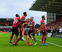 Lincoln City's Harry Anderson, centre, celebrates scoring the opening goal with team-mates, from left, John Akinde, Bruno Andrade, Joe Morrell and Harry Toffolo<br /> <br /> Photographer Chris Vaughan/CameraSport<br /> <br /> The Carabao Cup Second Round - Lincoln City v Everton - Wednesday 28th August 2019 - Sincil Bank - Lincoln<br />  <br /> World Copyright © 2019 CameraSport. All rights reserved. 43 Linden Ave. Countesthorpe. Leicester. England. LE8 5PG - Tel: +44 (0) 116 277 4147 - admin@camerasport.com - www.camerasport.com