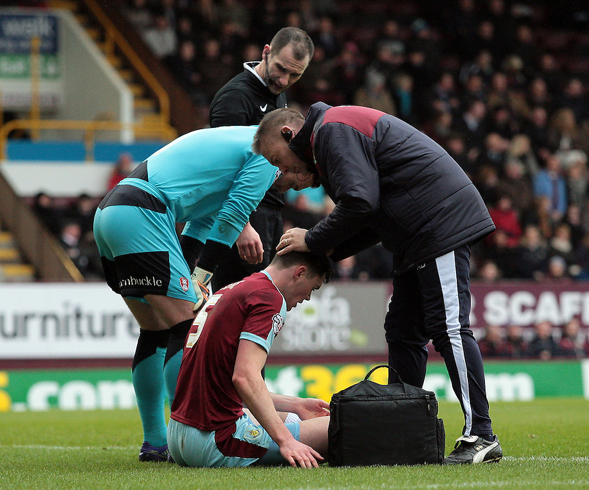 Burnley's Michael Keane receives treatment for a head injury during the first half<br /> <br /> Photographer David Shipman/CameraSport<br /> <br /> Football - The Football League Sky Bet Championship - Burnley v Rotherham United - Saturday 20th February 2016 - Turf Moor <br /> <br /> &copy; CameraSport - 43 Linden Ave. Countesthorpe. Leicester. England. LE8 5PG - Tel: +44 (0) 116 277 4147 - admin@camerasport.com - www.camerasport.com