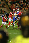 Barnsley 0 Huddersfield Town 1, 12/05/2006. Oakwell, League One Play Off Semi Final 1st Leg. Barnsley (red shirts) versus Huddersfield Town, Coca-Cola League One play-off semi-final first leg at Oakwell, Barnsley. The visitors won one-nil with a goal from Gary Taylor-Fletcher in 85 minutes. Picture shows two police officers in riot helmets watch Huddersfield on the attack. Photo by Colin McPherson.