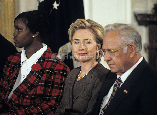 United States President Bill Clinton and first lady Hillary Rodham Clinton host an event in the East Room of the White House advocating expanded use of the internet to place adoptions in Washington, D.C. on November 24, 1998.  From left to right: Charday Mays;  the first lady; and Dave Thomas, founder of Wendy's.<br /> Credit: Ron Sachs / CNP/MediaPunch