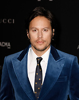 Cary Joji Fukunaga, wearing Gucci, attends 2018 LACMA Art + Film Gala at LACMA on November 3, 2018 in Los Angeles, California.      <br /> CAP/MPI/IS<br /> &copy;IS/MPI/Capital Pictures