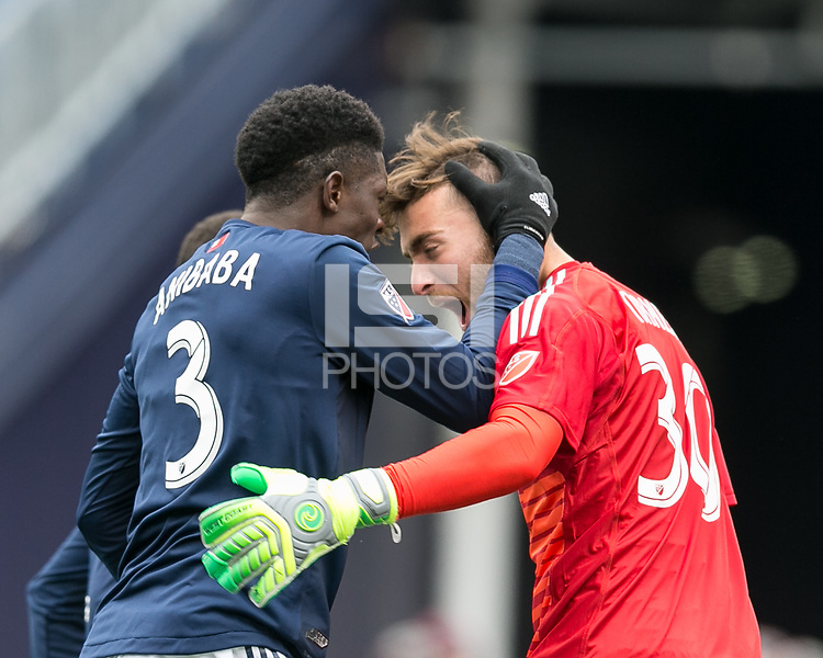 Foxborough, Massachusetts - March 10, 2018: In a Major League Soccer (MLS) match, New England Revolution (blue/white) defeated Colorado Rapids (yellow/blue), 2-1, at Gillette Stadium. Jalil Anibaba and Matt Turner celebrate penalty kick save.
