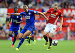 Daley Blind of Manchester United challenged by Islam Slimani of Leicester City during the Premier League match at Old Trafford Stadium, Manchester. Picture date: September 24th, 2016. Pic Sportimage
