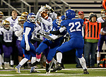 SIOUX FALLS, SD - OCTOBER 25: Brandon Volmer #17 from Winner bobbles the ball before securing it between a trio of defenders including Jett Olszewski #7 and Mitchell Goodbary #22 from Sioux Falls Christian in the first half of their 11B playoff game Thursday nigh at Bob Young Field in Sioux Falls.(Photo by Dave Eggen/Inertia)