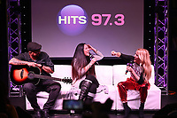 HOLLYWOOD, FL -  DECEMBER 05: DJ Kimmie B and Ellie Goulding during Hits Live at radio station Hits 97.3 on December 5, 2018 in Hollywood, Florida. Photo by MPI04 / MediaPunch
