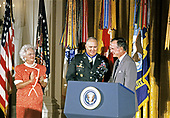 United States President George H.W. Bush and first lady Barbara Bush present the Presidential Medal of Freedom to US Army General Norman Schwarzkopf, Jr., commander, US Central Command, during a ceremony in the East Room of the White House in Washington, DC on July 3, 1991. General Schwarzkopf is being honored for his efforts to ensure the success of Operation Desert Shield / Operation Desert Storm and the liberation of Kuwait.<br /> Credit: Ron Sachs / CNP
