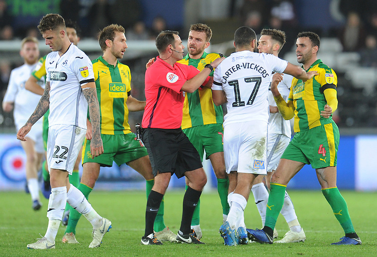 Swansea City's Cameron Carter-Vickers remonstrates with West Bromwich Albion's Hal Robson-Kanu during an altercation<br /> <br /> Photographer Kevin Barnes/CameraSport<br /> <br /> The EFL Sky Bet Championship - Swansea City v West Bromwich Albion - Wednesday 28th November 2018 - Liberty Stadium - Swansea<br /> <br /> World Copyright © 2018 CameraSport. All rights reserved. 43 Linden Ave. Countesthorpe. Leicester. England. LE8 5PG - Tel: +44 (0) 116 277 4147 - admin@camerasport.com - www.camerasport.com