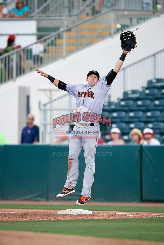 Jupiter Hammerheads first baseman Dustin Geiger (24) jumps to try to catch a high throw during a game against the Fort Myers Miracle on April 9, 2017 at CenturyLink Sports Complex in Fort Myers, Florida.  Jupiter defeated Fort Myers 3-2.  (Mike Janes/Four Seam Images)