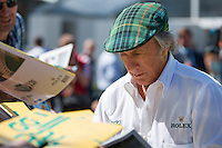 March 13, 2014: Sir Jackie Stewart signs autographs at the 2014 Australian Formula One Grand Prix at Albert Park, Melbourne, Australia. Photo Sydney Low.
