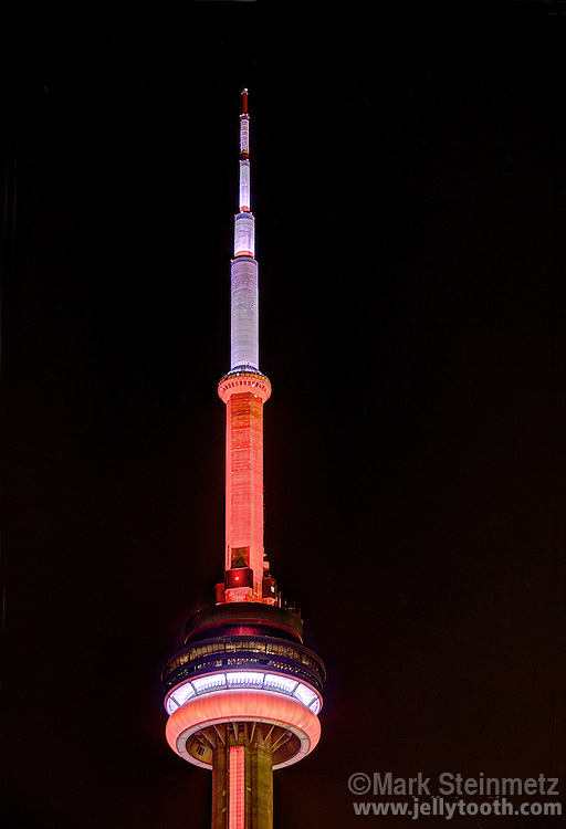Close-up of the top of the CN tower illuminated at night, Toronto, Ontario, Canada