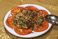 Tomato salad with couscous with herbs and mint. Efendi Efendy traditional Turkish and Ottoman Restaurant, The Block, Tirana. Albania, Balkan, Europe.