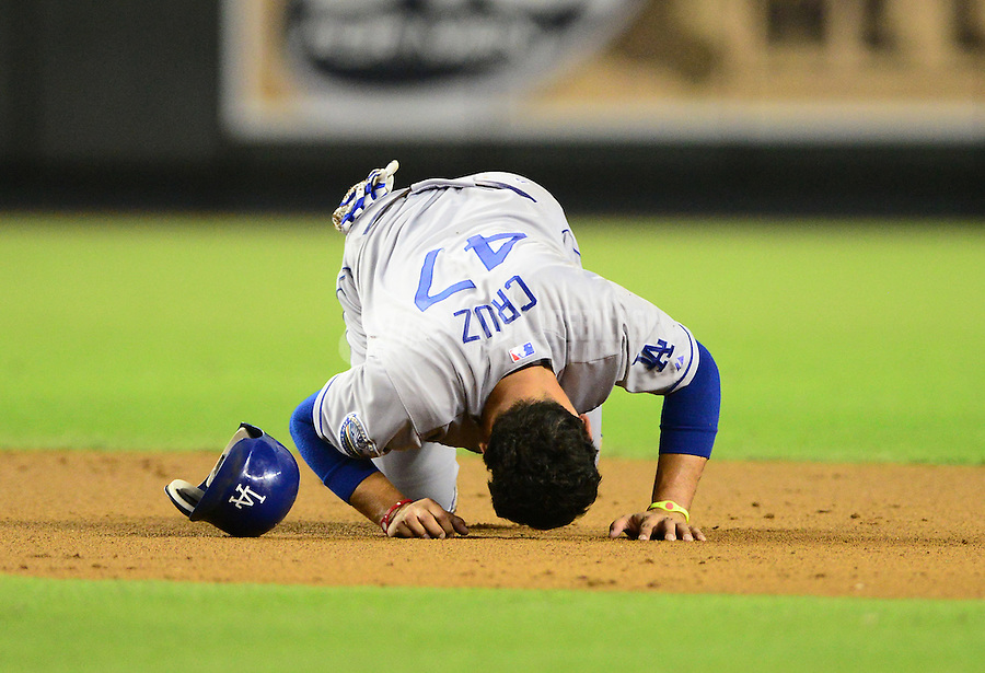 Sept. 11, 2012; Phoenix, AZ, USA: Los Angeles Dodgers infielder Luis Cruz reacts in pain after suffering an injury while sliding into second base in the second inning against the Arizona Diamondbacks at Chase Field. Mandatory Credit: Mark J. Rebilas-