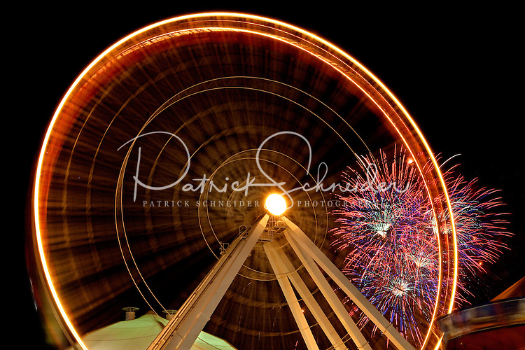 A giant Ferris wheel (150-foot-high Ferris wheel) makes a graphic contrast to the night at Chicago's Navy Pier on Lake Michigan near downtown Chicago, Ill. Navy Pier is a 50-acre park and promenade in downtown Chicago.