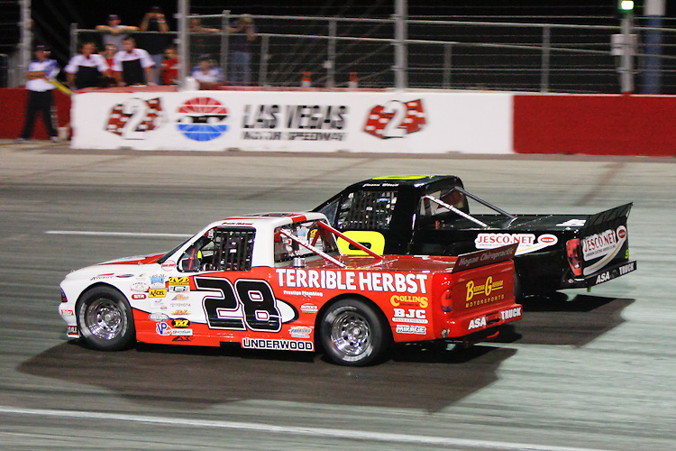 Two ASA Trucks battle for position at the Bullring at LVMS in Las Vegas, NV.