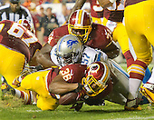 Washington Redskins running back Darrel Young (36) is stopped just short of the goal line by Detroit Lions linebacker Josh Bynes (57) during second quarter action at FedEx Field in Landover, Maryland on Thursday, August 20, 2015. Washington Redskins offensive guard Arie Kouandjio (74) tries to assist.<br /> Credit: Ron Sachs / CNP