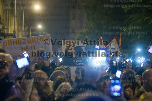 Participants hold their phones in the air to protest against the planned Internet tax in front of a ministry in Budapest, Hungary on October 26, 2014. ATTILA VOLGYI