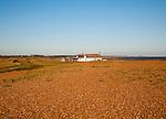 Seaside bungalow on shingle beach near North Weir Point, Shingle Street, Suffolk, England, UK