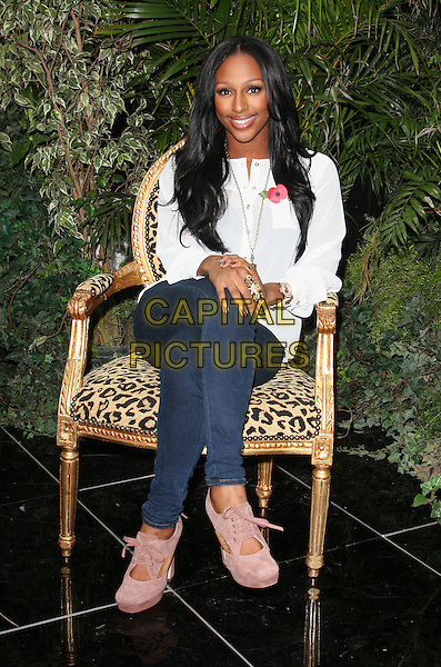 Alexandra Burke launches 'Lion King Diamond Edition' DVD at the Disney Store, Westfield Shopping Centre, London, England..November 6th 2011.full length sitting chair jeans denim pink suede shoes white shirt smiling legs crossed.CAP/ROS.©Steve Ross/Capital Pictures