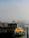 Sydney Ferries terminal at Circular Quays, in an early foggy morning.