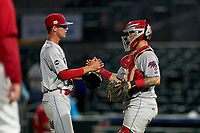 Clearwater Threshers pitcher Austin Ross (8) and catcher Rafael Marchan (24) celebrate after closing out a Florida State League game against the Palm Beach Cardinals on August 10, 2019 at Roger Dean Chevrolet Stadium in Jupiter, Florida.  Clearwater defeated Palm Beach 11-4.  (Mike Janes/Four Seam Images)