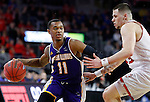 SIOUX FALLS, SD: MARCH 4: Delo Bruster #11 of Western Illinois looks past South Dakota defender Matt Mooney #13 on March 4, 2017 during the Summit League Basketball Championship at the Denny Sanford Premier Center in Sioux Falls, SD. (Photo by Dick Carlson/Inertia)