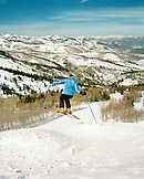 USA, Utah, woman skiing the bumps at Deer Valley Resort