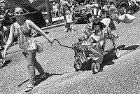 A woman pulls a wagon with an  independence themed during the Independence Parade Saturday July 2, 2016 on Beach Avenue in Cape May, New Jersey. Photo by William Thomas Cain/Cain Images