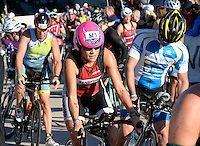 Mountain View, California's Amy Petermann heads down the ramp of Monona Terrace to begin the biking leg of the Wisconsin Ironman on Sunday in Madison