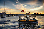 H2O taxi boat in Victoria harbour in a beautiful sunset scenery. Vancouver Island, BC, Canada 2017.